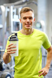 Smiling man with protein shake bottle Royalty Free Stock Photography