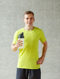Smiling man with protein shake bottle Royalty Free Stock Image