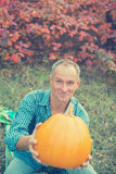 Smiling man with pumpkin for gift Royalty Free Stock Photos