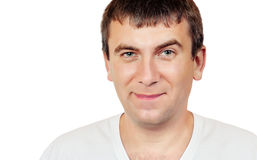 Smiling man with a raised eyebrow stock images