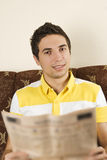 Smiling man read newspaper Royalty Free Stock Image