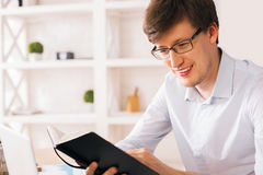 Smiling man reading book side Stock Images