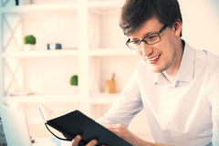Smiling man reading book Stock Images