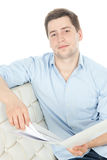 Smiling man reading documents over white Royalty Free Stock Photography