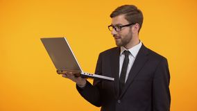 Smiling man reading e-mail and showing ok sign, winking at camera, promotion. Stock footage stock video footage