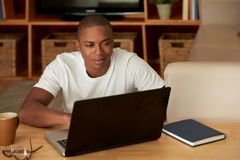 Young man working from home Royalty Free Stock Images