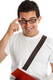 Smiling man reading a texbook Royalty Free Stock Photography