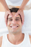 Smiling man receiving head massage Stock Photography