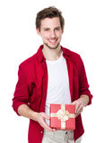 Smiling man in red shirt with gift box Stock Photo