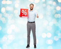 Smiling man with red shopping bag Stock Photography