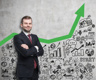Smiling man in red tie and green graph Royalty Free Stock Photos