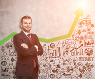 Smiling man in red tie and green graph at sunshine Royalty Free Stock Photography