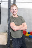 Smiling man rests in crossfit center Stock Photo