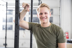 Smiling man rests in fitness gym center Royalty Free Stock Photography