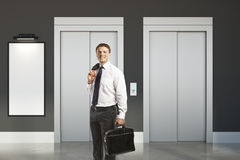 Smiling man in room with lift Stock Images