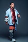 Smiling man runs on clothing sale Royalty Free Stock Image
