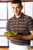 Smiling man with salad plate Royalty Free Stock Photos