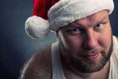 Smiling man in Santa Claus hat Stock Photos