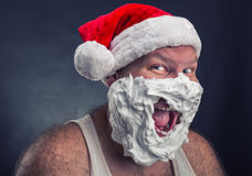 Smiling man in Santa Claus hat Stock Photos