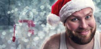 Smiling man in Santa Claus hat Royalty Free Stock Images