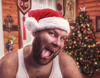 Smiling man in Santa Claus hat Stock Images