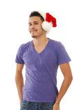 Smiling man in a Santa hat Stock Photos