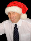 Smiling man with Santa hat Stock Photography