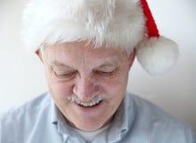 Smiling man in Santa hat Royalty Free Stock Photography