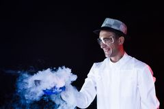 Smiling man scientist with dry ice Royalty Free Stock Image