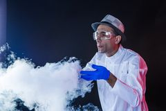 Smiling man scientist with dry ice Royalty Free Stock Photo