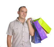 Smiling man with several shopping bags Royalty Free Stock Image