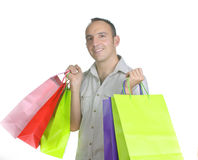 Smiling man with several shopping bags Stock Images
