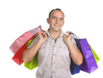 Smiling man with several shopping bags Royalty Free Stock Photos