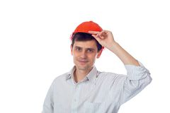Smiling man in a shirt orange construction helmet Royalty Free Stock Photos