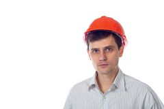 Smiling man in a shirt orange construction helmet Royalty Free Stock Image