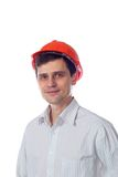 Smiling man in a shirt orange construction helmet Royalty Free Stock Images
