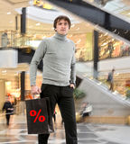 Smiling man  with shopping bag Royalty Free Stock Images