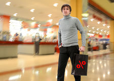 Smiling man with shopping bag Stock Images