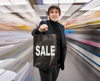 Smiling man with shopping bag Royalty Free Stock Image
