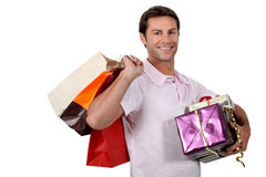Smiling man with shopping bags Royalty Free Stock Photo