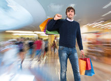 Smiling man with shopping bags Stock Image