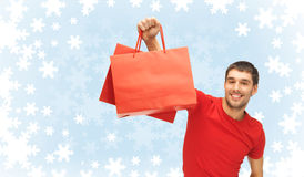 Smiling man with shopping bags Royalty Free Stock Images