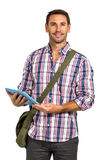 Smiling man with shoulder bag using tablet and looking at the camera Royalty Free Stock Photo