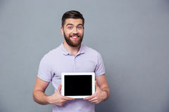 Smiling man showing blank tablet computer screen Royalty Free Stock Photo