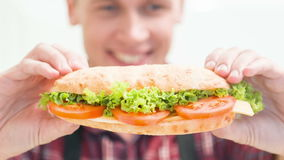Smiling man showing done sandwich stock video footage