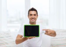Smiling man showing tablet pc blank screen at home Stock Photography