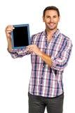 Smiling man showing tablet screen at camera Stock Photos