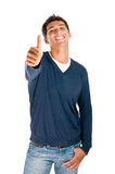 Smiling man showing thumb up Royalty Free Stock Photo
