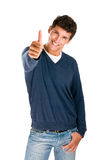 Smiling man showing thumb up stock photo