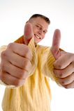 Smiling man showing  thumbs up with both hands Royalty Free Stock Photos